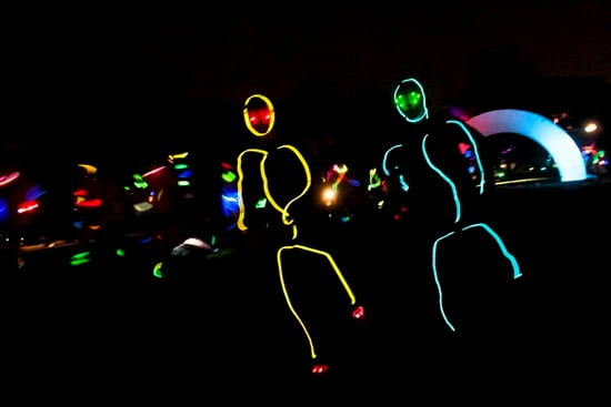 electric runners in neon lights