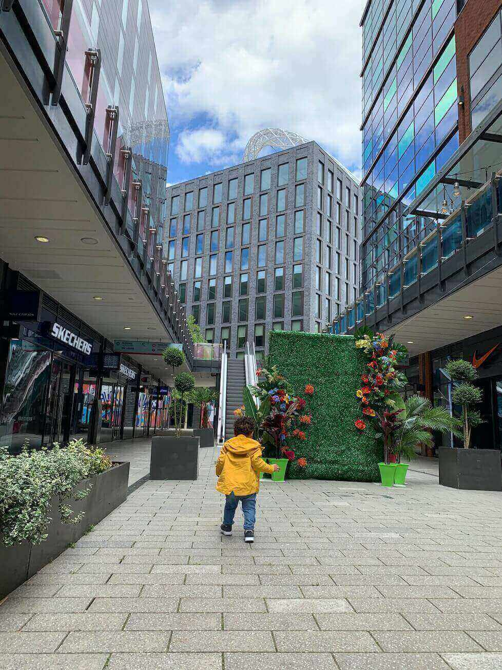 boy wonders through London designer outlet